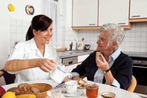 caregiver preparing meal for her patient